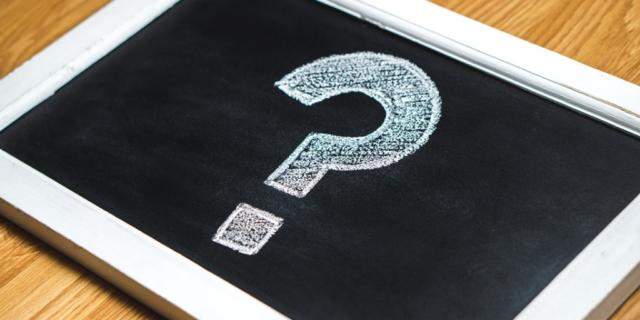 Question mark drawn on a small chalkboard