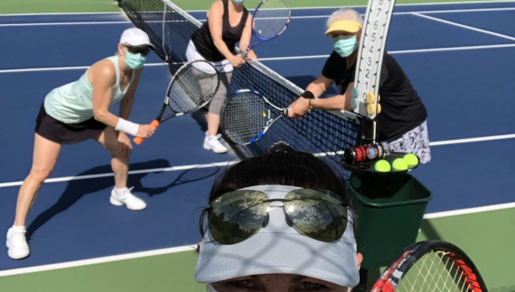 Judie Fuller and her team on court, wearing safety masks.